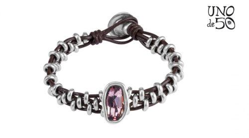 Bracciale Uno de 50 I will survive PUL1196RSAMTL0M realizzato con 4 fili di pelle marrone con perline in argento e al centro cristallo Swarovski rosa