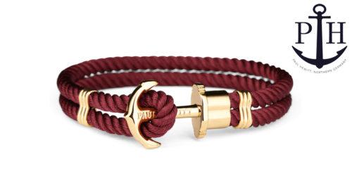 Bracciale Paul Hewitt Phrep Ip Oro Nylon in stile marinaro, disponibile in sette misure e diverse colorazioni. Il bracciale è chiuso con un fermaglio a forma di ancora, mentre il cinturino è in nylon.