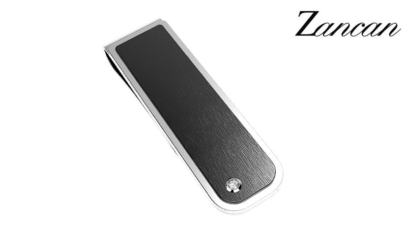 Il Fermasoldi Zancan acciaio e zaffiro bianco è realizzato in acciaio ipoallergenico con uno zaffiro bianco alla base. Dimensioni: 15x53 mm.