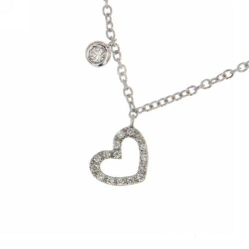 Collana Donna Mirco Visconti Z590/10. Collana realizzata in oro 18 KT. Modello con catenina veneziana e pendente a forma di cuore traforato tempestato da diamanti. Questo gioiello presenta diamanti di ct 0,02 e ct 0,05 col G VS.