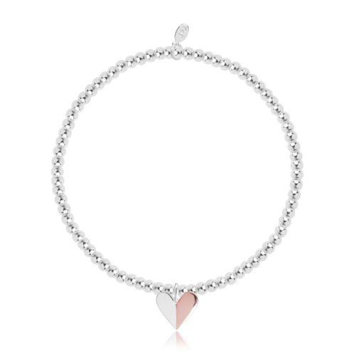 Bracciale donna Joma 1965. Braccialetto elastico della collezione New Two Tone Heart in ottone placcato in argento con charme a forma di cuore bicolore placcato in argento e oro rosa.