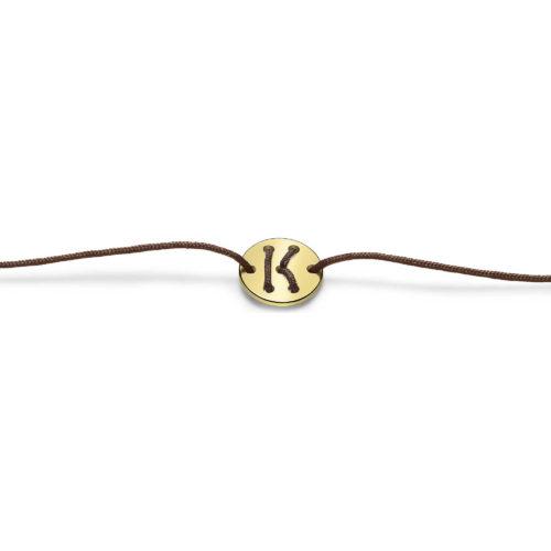 Bracciale Unisex Feelo FLJ0011 , by Breil, con lettera K , realizzato in cordino colorato marrone e targhetta in argento 925 color oro. La lettera K di KARMA.