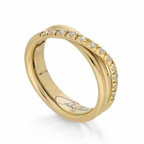 Anello Filodellavita AN8GBT. Anello della collezione Classic, 3 fili in oro giallo 9kt e 12 diamanti bianchi 0.21ct.