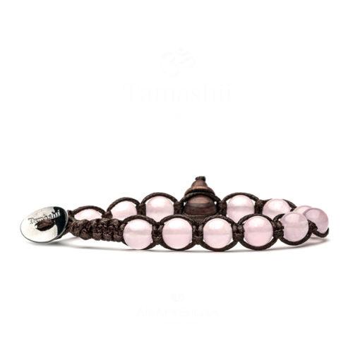 Bracciale unisex Tamashii Classic BHS900-199. Bracciale realizzato con un cordino di cotone, calabash in legno, sfere di giada rosa del diametro di 8 mm e bottone metallico di chiusura. Lunghezza regolabile da 16 cm a 23 cm.