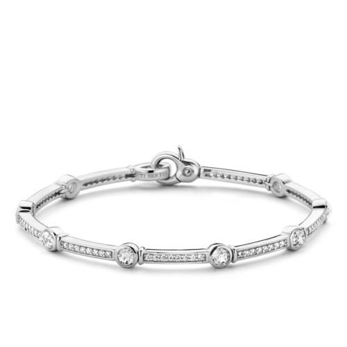 Bracciale Donna Ti Sento 2892ZI. Bracciale rigido in argento sterling rodiato formato da maglie rettangolari alternate a luminosi zirconi incassati in castoni tondi.